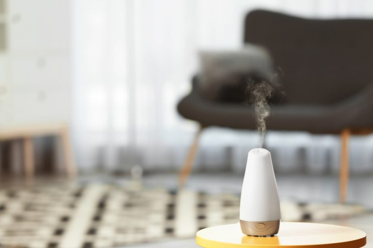 Aroma Oil Diffuser on Table Against